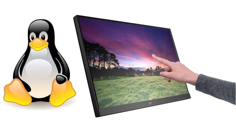 Tux y pantalla táctil